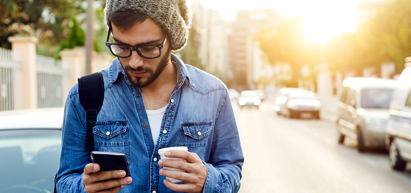 Modern young man with mobile phone